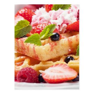 Waffle cake with fresh berry fruit postcard