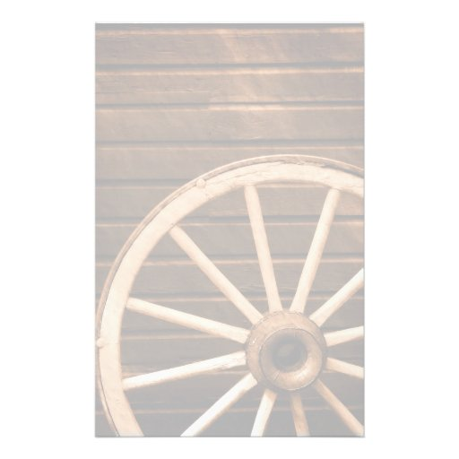 Wagon wheel leaning against old wooden wall customized stationery