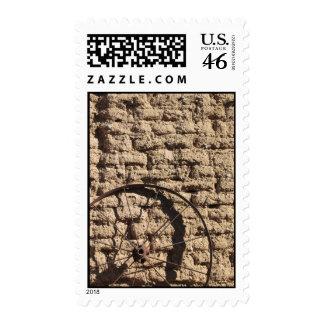 Wagonwheel on Brick Wall Postage