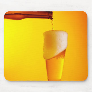 Waiter pouring beer, glass of a cold drink mouse pads