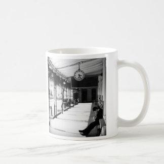 Waiting at the train station coffee mug