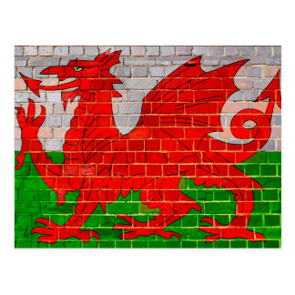 Wales flag on a brick wall postcard