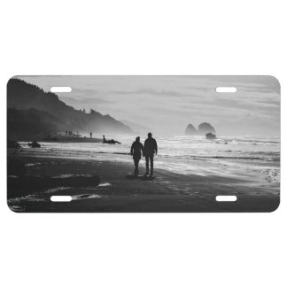 Walking hand-in-hand on the beach license plate