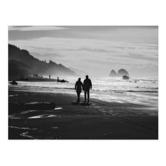 Walking hand-in-hand on the beach postcard