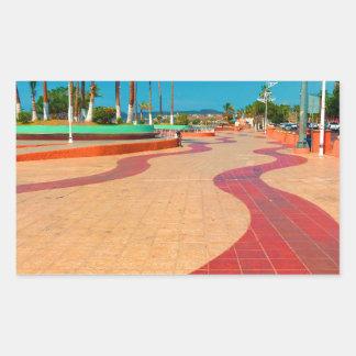Walking on the streets of Baja Rectangular Sticker