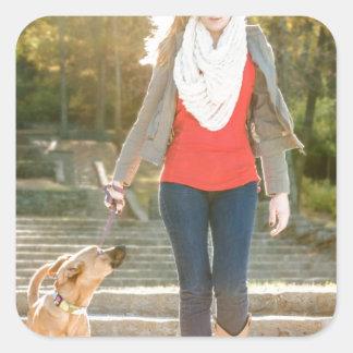 Walking the dog square sticker