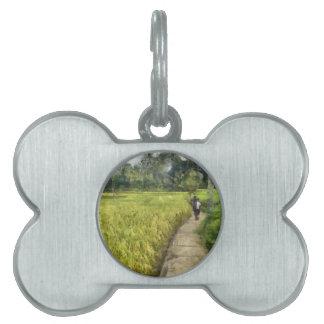 Walking through some fields pet name tag