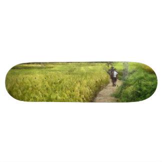 Walking through some fields skateboard
