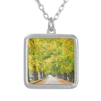 Walkway full of trees silver plated necklace