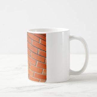 Wall of decorative red bricks close up coffee mug