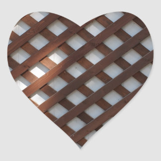 Wall of the building covered wooden planks crosswi heart sticker