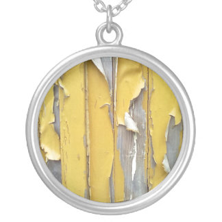 wall yellow flaking paint necklaces
