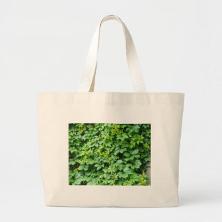 Wallpaper from leaves of grapes large tote bag