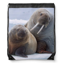 Walrus cow and calf rest on a sea ice floe drawstring bag