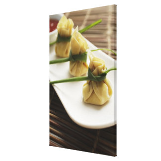 wanton dumplings with white chili sauce canvas print