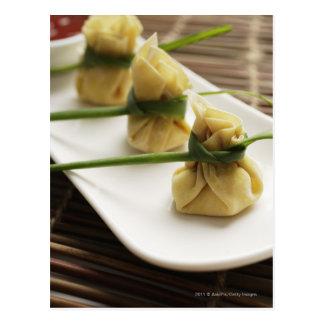 wanton dumplings with white chili sauce postcard