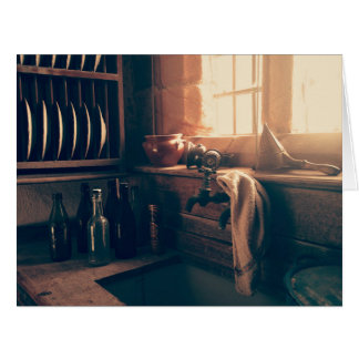 Warm light in a rustic kitchen large greeting card