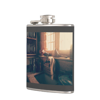 Warm light in a rustic kitchen hip flask