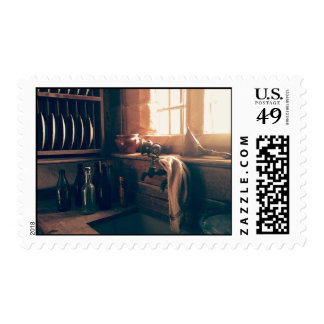 Warm light in a rustic kitchen postage stamp