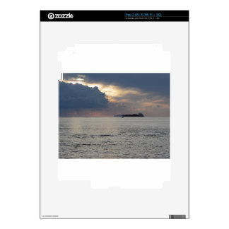 Warm sea sunset with cargo ship and a small boat decals for the iPad 2