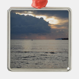 Warm sea sunset with cargo ship and a small boat metal ornament