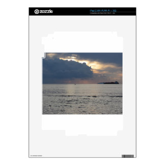 Warm sea sunset with cargo ship and a small boat skin for iPad 2