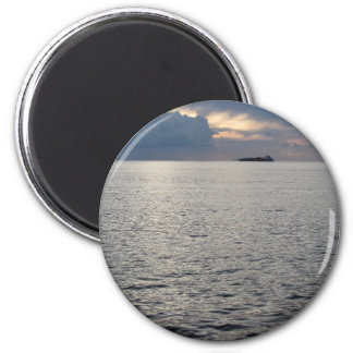 Warm sea sunset with cargo ship at the horizon 2 inch round magnet