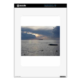 Warm sea sunset with cargo ship at the horizon skins for iPad