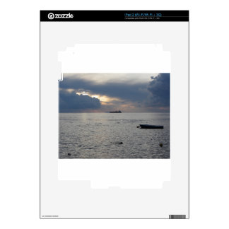 Warm sea sunset with cargo ship at the horizon skins for iPad 2