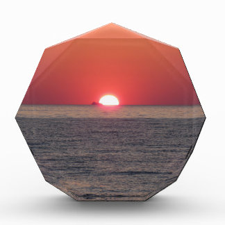 Warm sea sunset with cargo ship in the background award