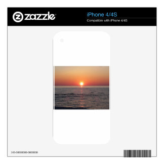 Warm sea sunset with cargo ship in the background decal for the iPhone 4