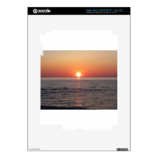 Warm sea sunset with cargo ship in the background skin for iPad 3