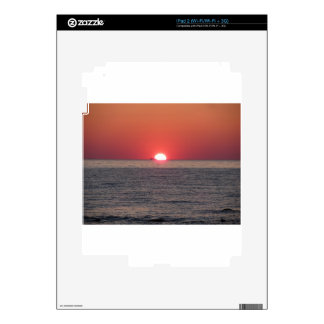 Warm sea sunset with cargo ship in the background skins for the iPad 2