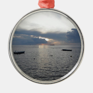 Warm sea sunset with cargo ships metal ornament