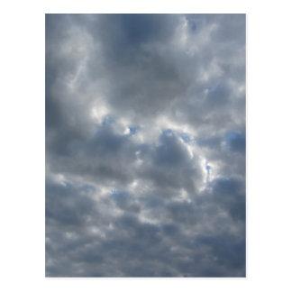 Warm sky with giants cumulonimbus clouds at sunset postcard