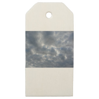 Warm sky with giants cumulonimbus clouds at sunset wooden gift tags