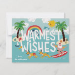 """Warmest Wishes Funny Surfing Santa and Beach Holiday Card<br><div class=""""desc"""">Funny surfing santa is being pulled by his swim suit clad reindeer in this fun,  beach themed holiday card. Also featuring your classic decorated Christmas palm trees and seasonal sea creatures.</div>"""