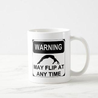 Warning may flip coffee mug