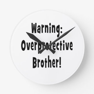 warning overprotective brother black text round clock