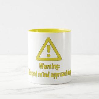 Warning warped mind approaching mugs