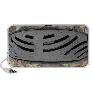 Warped grate mini speaker