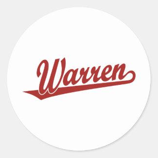 Warren script logo in red round sticker