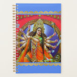 "Warrior Goddess Durga Shakti Planner<br><div class=""desc"">Let blessed Devi Durga Ji help you keep life and household organized with this artistic Hindu goddess planner calendar. Durga is the mother of the universe and believed to be the power behind the work of creation, preservation, and destruction of the world. The conch shell in Durga&#39;s hand symbolizes the...</div>"