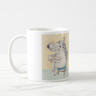 warthog sitting on stool with embroidery, and poem coffee mug