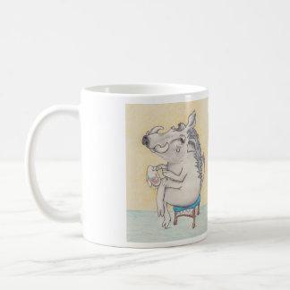 warthog sitting on stool with embroidery, and poem coffee mug