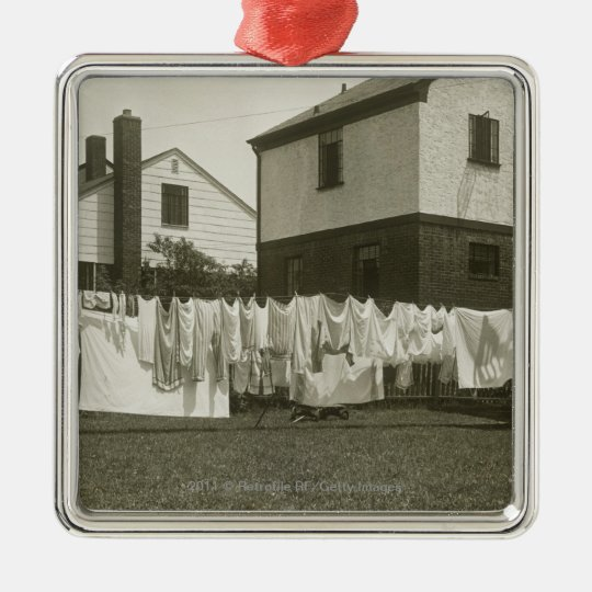 Washing line outside houses metal ornament