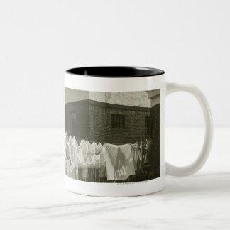 Washing line outside houses Two-Tone coffee mug