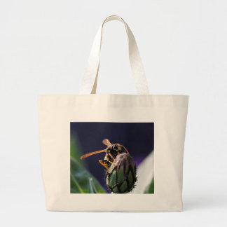 wasp on flower canvas bags