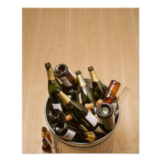 Waste bin full of empty champagne bottles on poster