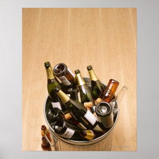 Waste bin full of empty champagne bottles on poster